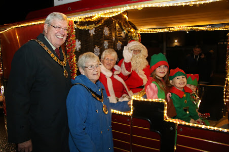 the mayor and deputy mayor with santa and mrs claus